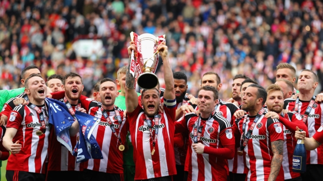 Sheffield United celebrate promotion to the Premier League