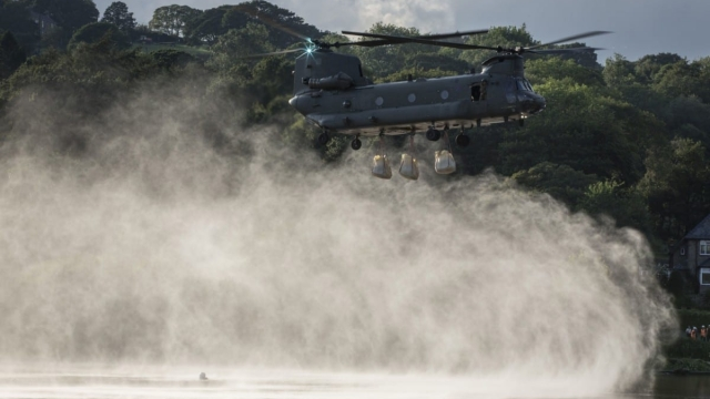 Ministry of Defence handout photo of sandbags being brought in by an RAF Chinook helicopter to help repair the dam at Toddbrook reservoir near the village of Whaley Bridge (Photo:PA)