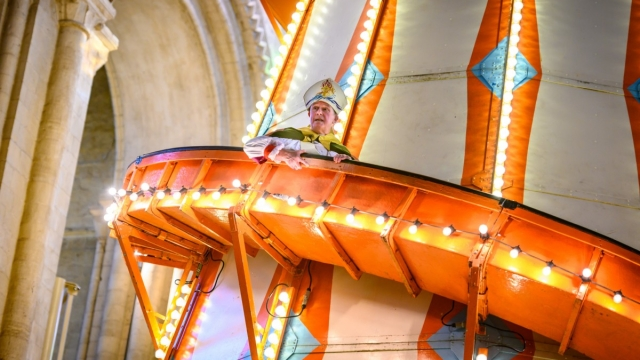 The Bishop of Lynn, the Rt Revd Jonathan Meyrick, stopped halfway down the slide to deliver his sermon. (