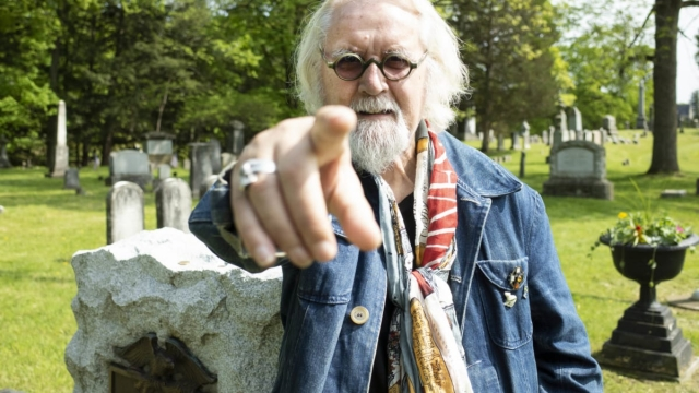 Billy Connolly at the grave of Uncle Sam on Billy Connolly's Great American Trail (Photo courtesy of ITV)