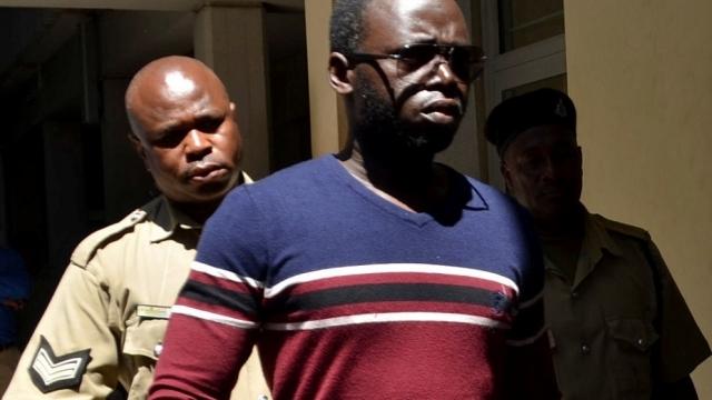 Erick Kabendera arriving at the Kisutu Residents Magistrate Court in Dar es Salaam on Monday, 5 August. (Photo: Reuters/Emmanuel Herman)