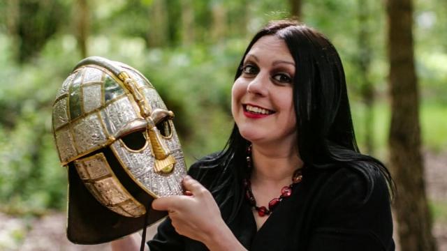 Dr Janina Ramirez with replica Sutton Hoo helmet