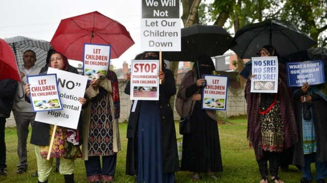 Protesters outside Anderton Park Primary School, in Moseley, Birmingham