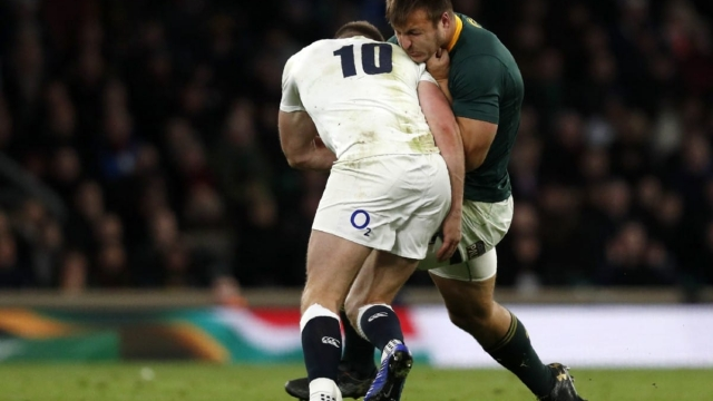 England's fly-half Owen Farrell makes a dubious tackle on South Africa's Andre Esterhuizen (AFP/Getty Images)