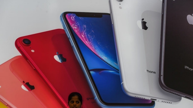 Visitors are seen at the newly launched Apple store in Mumbai on August 2, 2019. (Photo by Indranil MUKHERJEE / AFP) (Photo credit should read INDRANIL MUKHERJEE/AFP/Getty Images)