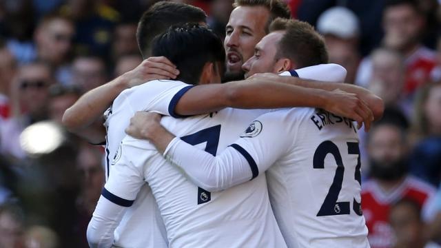 Tottenham Hotspur's midfielder Christian Eriksen celebrates with teammates after scoring (AFP/Getty Images)