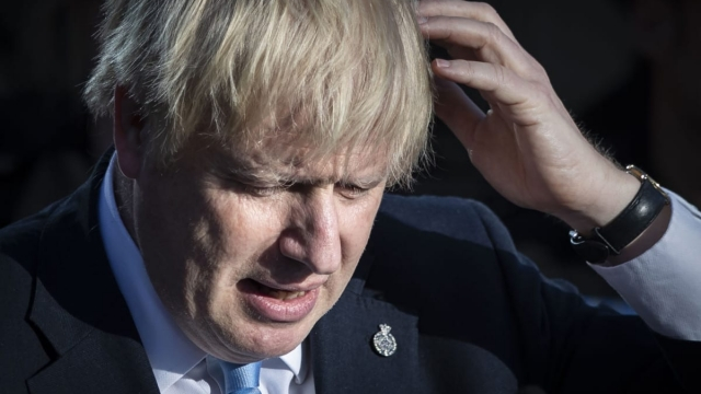 Article thumbnail: Britain's Prime Minister Boris Johnson reacts during a visit with the police in West Yorkshire on 5 September 2019 (AFP/Getty Images)