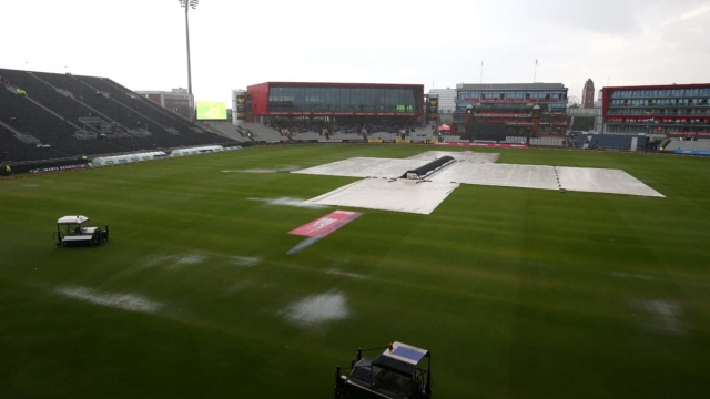 Covers are seen on the pitch as the Vitality Blast match between Lancashire Lightning and Yorkshire Vikings is abandoned due to heavy rain