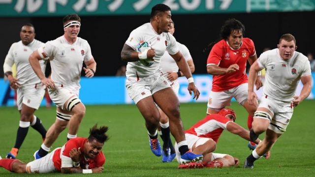 England's centre Manu Tuilagi runs with the ball against Tonga (AFP/Getty Images)