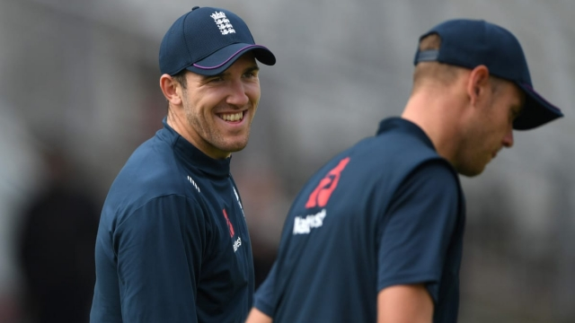 Craig Overton shares a joke with Stuart Broad during an England nets session