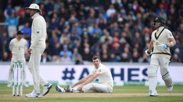 Article thumbnail: Craig Overton looks frustrated at Old Trafford after another tough day with ball in hand