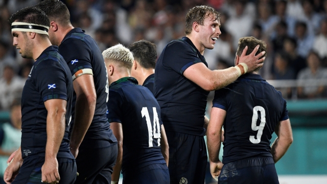 Article thumbnail: Scotland's scrum-half Greig Laidlaw celebrates with teammates after scoring a try (AFP/Getty Images)