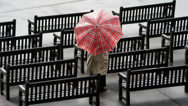 A lone racegoer watches the racing as rain falls at Newmarket racecourse on Friday. (Photo: Alan Crowhurst/Getty Images)