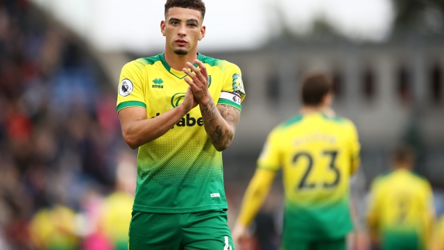 Article thumbnail: Ben Godfrey applauds the travelling Norwich fans at full time