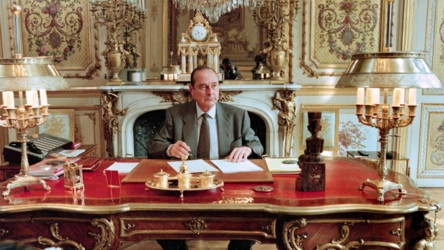 French President Jacques Chirac poses in his office at the Elysee palace in
