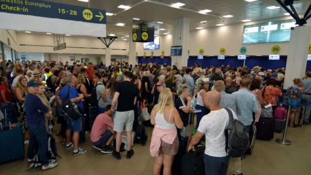 British passengers with Thomas Cook queue for flights home from Ioannis Kapodistrias airport in Corfu yesterday