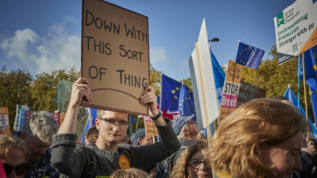 Protesters march towards Parliament Square demanding a final say on the Government's Brexit deal during the People's Vote Rally