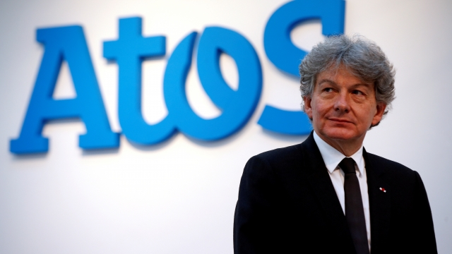 Atos Chairman and CEO Thierry Breton poses in front of the company's logo (Photo: REUTERS/Philippe Wojazer/File Photo)
