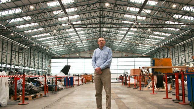 Article thumbnail: Robert Vickery in one of the Air Accidents Investigation Branch's engineering analysis hangars (Photo: Rob Hastings)