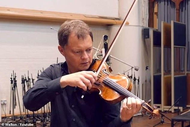 Stephen Morris, pictured playing his lost violin