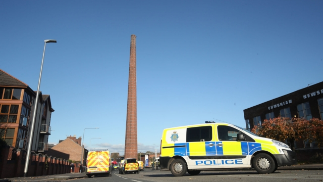 Police vehicles block the road near to Dixon's Chimney in Carlisle, Cumbria