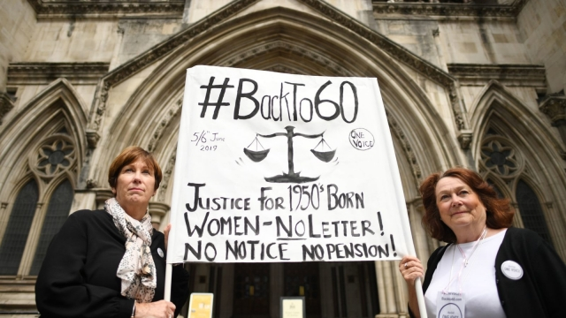 Two campaigners from Backto60 outside the Royal Courts of Justice during the judicial review