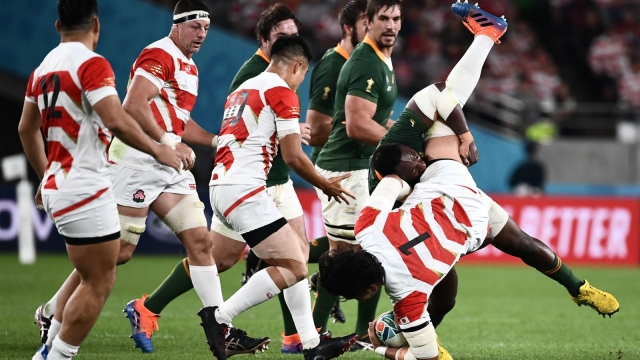 Japan's prop Keita Inagaki is tackled by South Africa's prop Tendai Mtawarira (AFP via Getty Images)
