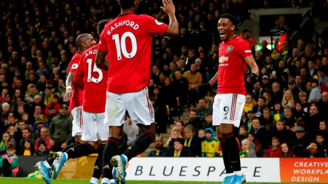 Manchester United's French striker Anthony Martial celebrates with teammates after scoring their third goal (AFP via Getty Images)