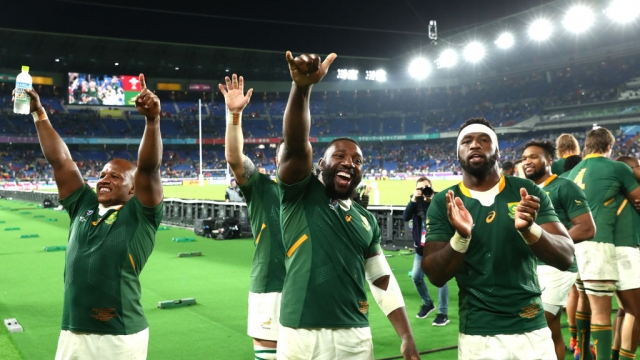 Mbongeni Mbonambi of South Africa celebrates with Tendai Mtawarira and Siya Kolisi after beating Wales (Getty Images)