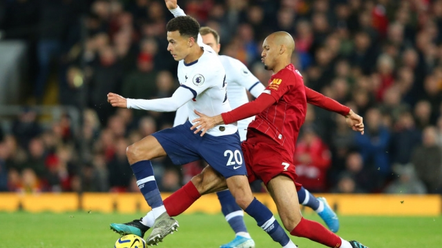 Dele Alli of Tottenham Hotspur is challenged by Fabinho of Liverpool (Getty Images)