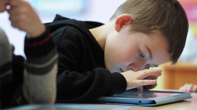 Article thumbnail: Nursery school pupils work with tablet computers on March 18, 2013 in Haguenau, northeastern France. AFP PHOTO / FREDERICK FLORIN (Photo credit should read FREDERICK FLORIN/AFP/Getty Images)