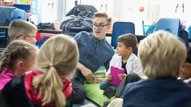 McBusted's Tom Fletcher reads with children as we discuss the merits of homework