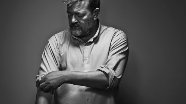 Guy Garvey says Elbow's new album was inspired by the death of his father and of close friends, but he didn't want it to 'fall over a sad cliff'