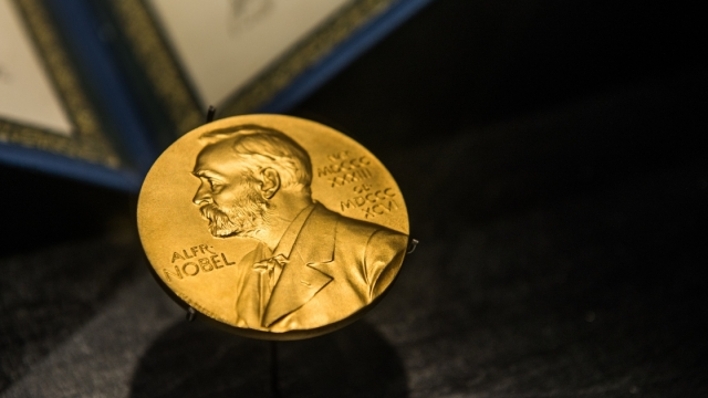 A golden image of the Nobel Prize decorates the front of the Science Museum in Singapore