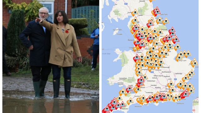 Britain's Labour Party leader Jeremy Corbyn and parliamentary candidate for Don Valley Caroline Flint view the aftermath of flooding in Conisborough, near Doncaster, on 9 November 2019 (AFP via Getty Images)
