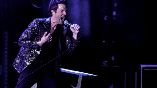 Article thumbnail: Brandon Flowers of The Killers performs on stage (Photo: Kevin Winter/Getty)