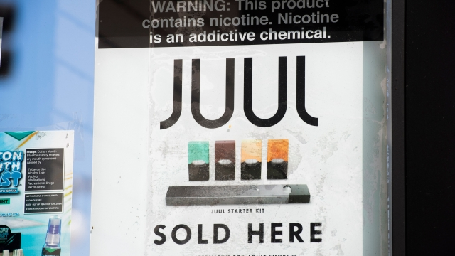 A sign advertises Juul vaping products in Los Angeles, California, September 17, 2019. - New York became the second US state to ban flavored e-cigarettes September 17, following several deaths linked to vaping that have raised fears about a product long promoted as less harmful than smoking. (Photo by Robyn Beck / AFP) (Photo credit should read ROBYN BECK/AFP via Getty Images)