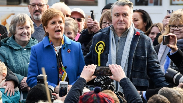 Nicola Sturgeon, pictured with former SNP MP John Nicolson, as she bids to persuade Remain voters to back SNP
