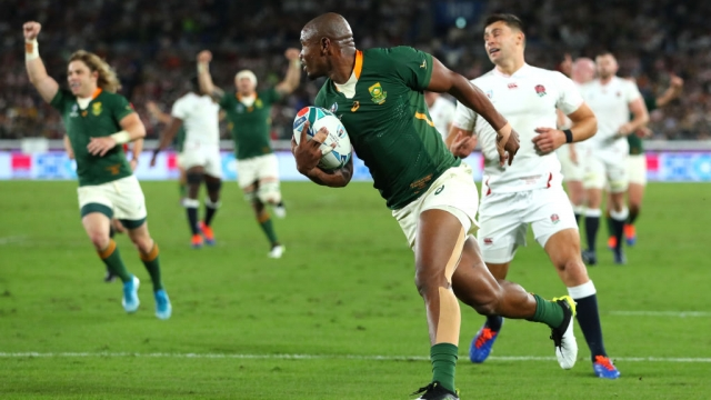 Makazole Mapimpi of South Africa breaks through to score his team's first try (Getty Images)