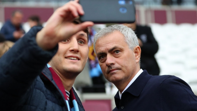 Jose Mourinho manager of Tottenham Hotspur has a selfie photo with a fan at London Stadium on 23 November 2019 (Getty Images)
