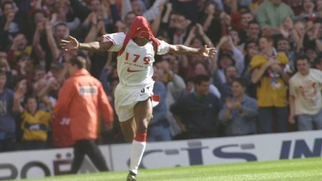 Ian Wright of Arsenal celebrates breaking the Arsenal goal scoring record set by Cliff Bastin