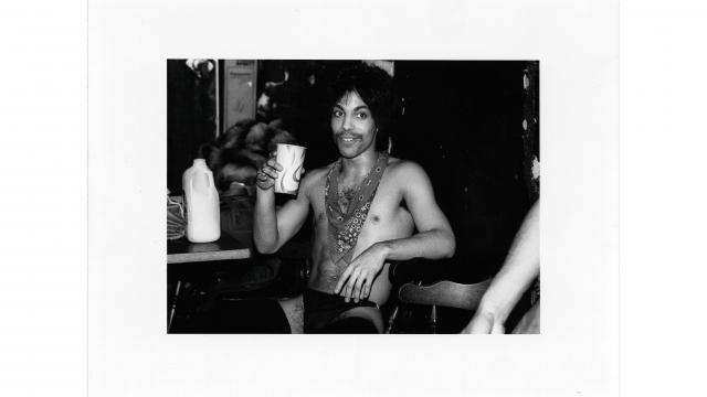 Prince sips orange juice backstage during the Dirty Mind tour, 1981 (Photo: © 1985 Allen Beaulieu)