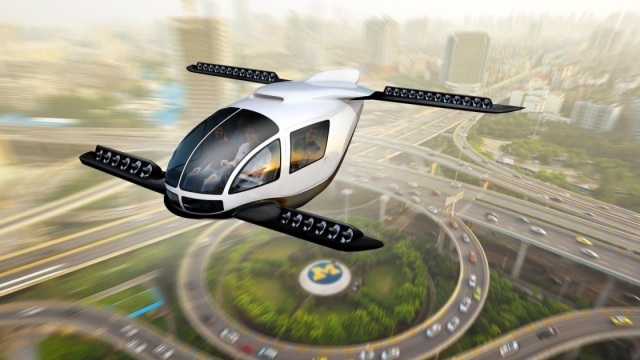 Could a flying electric taxi cruising be over a busy city centre soon? (Photo: Dave Brenner/University of Michigan School for Environment and Sustainability/PA Wire)
