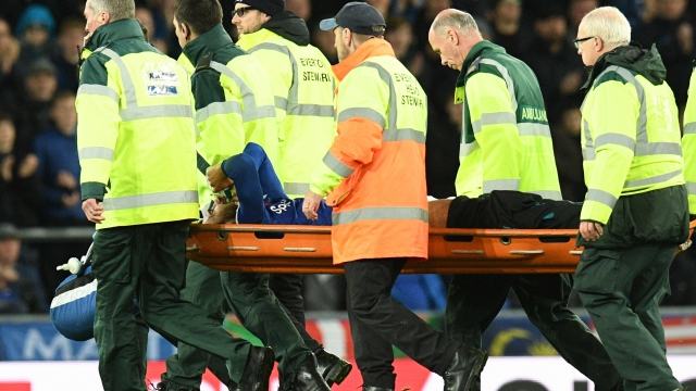 André Gomes leaves the pitch on a stretcher at Goodison Park on Sunday