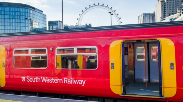 A South Western Railway train at London Waterloo Station with the London eye in the background