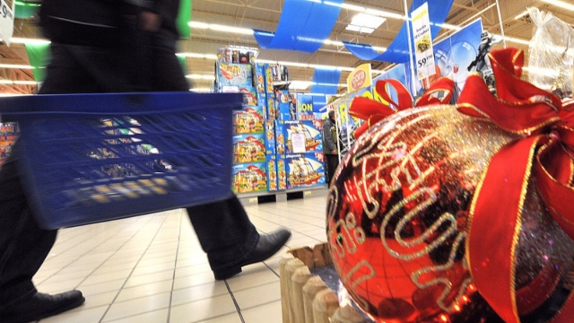 A customer walks past Christmas decorations as he shops in a supermarket