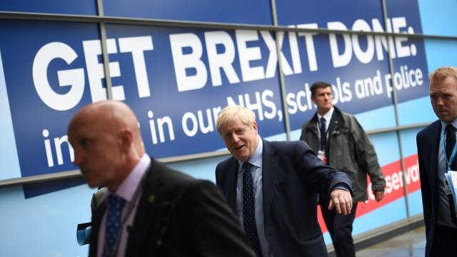"""Prime Minister Boris Johnson gathered his Conservative party Sunday for what could be its final conference before an election, promising to """"get Brexit done"""". (Photo credit should read OLI SCARFF/AFP via Getty Images)"""
