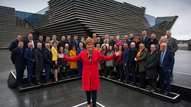 Article thumbnail: Nicola Sturgeon with her new intake of MPs after the 2019 general election (Photo: Getty)