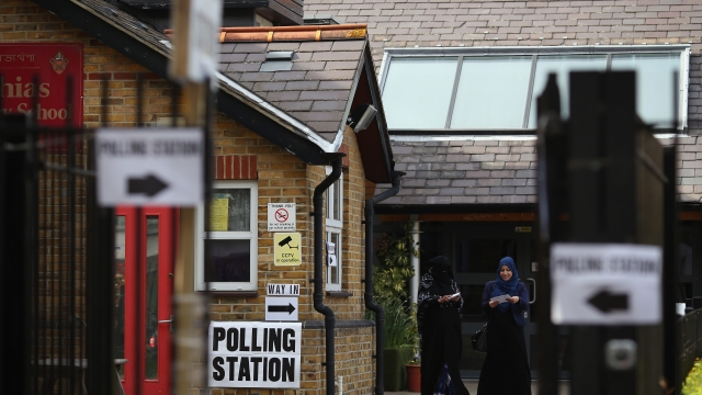 Muslim women leave a polling station