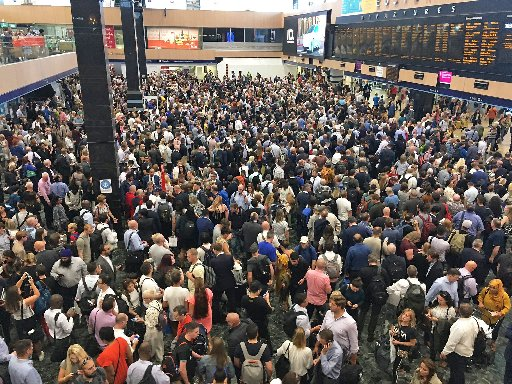 Rail passengers faced chaos on the first working day of the new timetable (Stock photo of travel chaos at Euston in May)